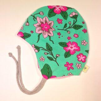 Rund lue frisk grønn med rosa blomster