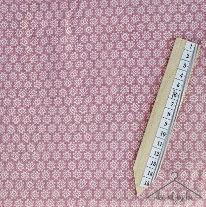 Pudderrosa små hvite blomster på rad