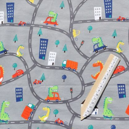 Dinosaurer på ville veier i bil stoff klær tøy
